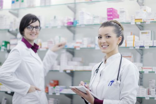 team of pharmacist chemist woman in pharmacy drugstore
